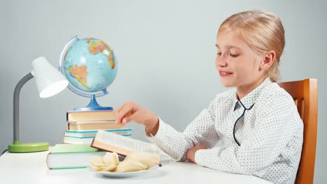 Schoolgirl-Eating-Potato-Chips-And-Reading-Textbook-At-The-Table