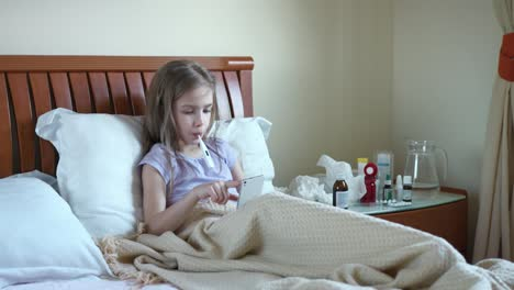 Sick-Girl-7-Years-Old-Sitting-On-The-Bed-Under-The-Blanket-01