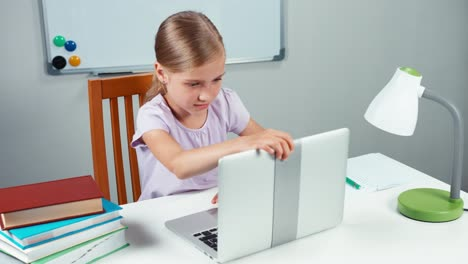 Student-Child-Girl-7-8-Years-Opening-Laptop-And-Something-Typing-On-PC