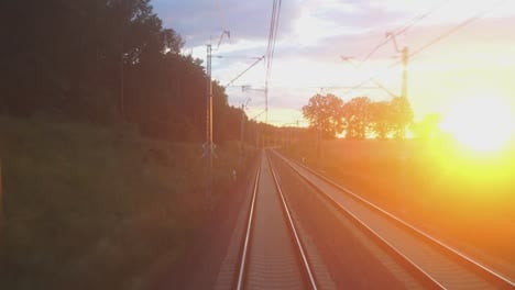 Track-Shot-From-The-Last-Car-Of-The-Train-At-Sunset-Or-Sunrise