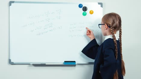 Very-Smart-Nerd-With-Glasses-Standing-Near-Whiteboard-Smiling-At-The-Camera