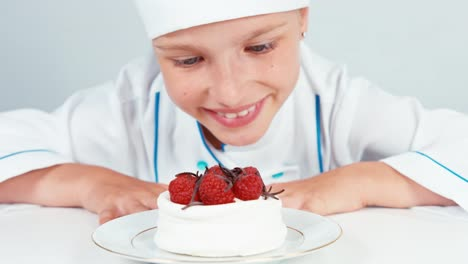Young-Baker-Decorating-Meringue-Cake-And-Smiling-At-Camera-Close-Up-Portrait