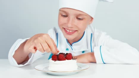 Young-Baker-Decorating-Meringue-Cake-Using-Chocolate-And-Smiling-At-Camera-02