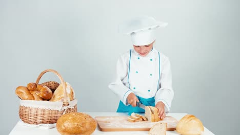 Young-Baker-Girl-7-8-Years-Cutting-Loaf-Of-Bread-And-Eating-One-Piece