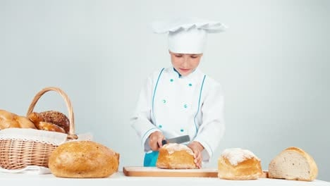 Young-Baker-Girl-7-8-Years-Cutting-Loaf-Of-Bread-And-Gives-You-One-Piece
