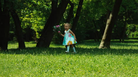Baby-Girl-3-Years-Old-Child-Holding-Bouquet-Of-Flowers-Running-At-Mother