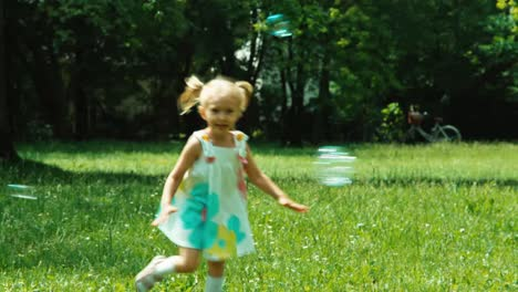 Baby-Girl-3-Years-Playing-With-Soap-Bubbles-In-The-Park