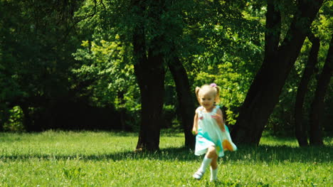 Baby-Girl-3-Years-Running-At-Camera-In-The-Park-And-Laughing