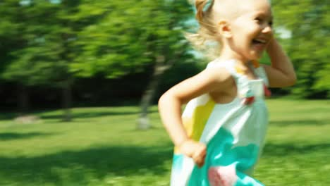 Baby-Girl-Child-Running-In-The-Park-At-Camera