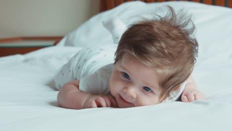 Beautiful-Newborn-Baby-Girl-Boy-Lying-On-His-Stomach