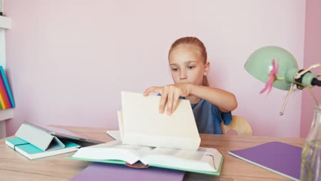 Blond-Student-Girl-9-Aged-Doing-Homework-In-The-Bedroom-Child-Girl-Takes-Out