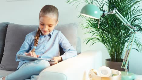 Cheerful-Blonde-Girl-9-Years-Old-Using-Tablet-PC-Is-Online