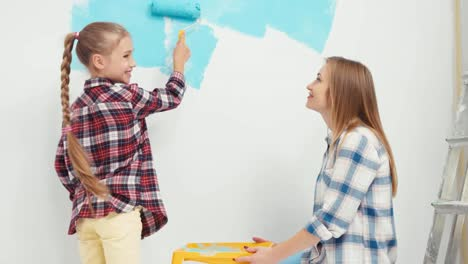 Cheerful-Family-Painting-Wall-At-Home