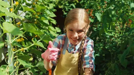 Cheerful-Farmer-Girl-With-Her-Vegetables-In-Her-Kitchen-Garden