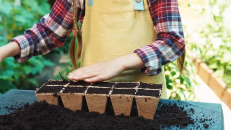 Cheerful-Girl-Working-With-Soil