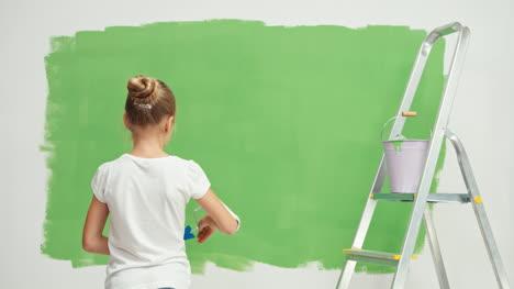 Cheerful-Painter-Near-Green-Screen