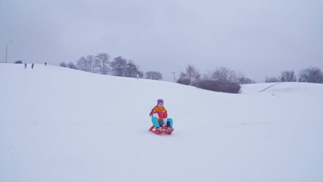 Child-Girl-8-Years-Old-Sliding-Downhill-On-Sled-In-Wintertime