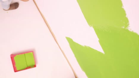 Child-Girl-9-Years-Old-Painting-Wall-To-Green-Colors