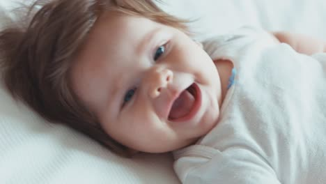 Extreme-Closeup-Face-Of-A-Happy-Newborn-Baby-Girl-Boy-Smiling-At-Camera-Top