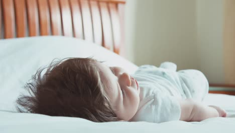 Newborn-Baby-Lying-On-The-Bed