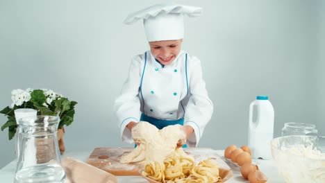 Young-Baker-Girl-Making-Dough-At-The-Kitchen-Table