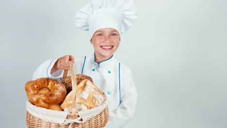 Young-Baker-Holds-Basket-With-Bread-And-Smiling-At-Camera-Isolated-On-White
