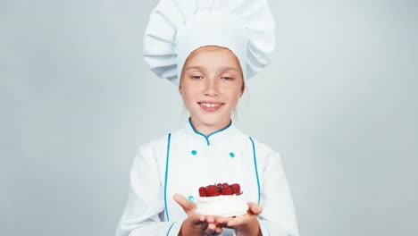 Young-Baker-Holds-In-Hands-Meringue-Cake-And-Gives-You-It-And-Smiling-At-Camera
