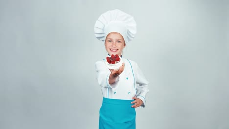 Young-Baker-Holds-In-Her-Hand-Meringue-Cake-And-Smiling-At-Camera-Isolated