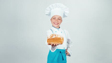 Young-Baker-Holds-Loaf-Of-Bread-In-Her-Hands-And-Gives-You-And-Smiling-At-Camera
