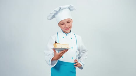Young-Baker-Holds-Piece-Of-Cheesecake-And-Gives-You-It-Chef-7-8-Years-Smiling
