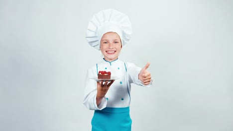 Young-Baker-Holds-Plate-With-Chocolate-Cake-With-Raspberries-And-Gives-You-It