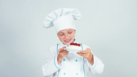 Young-Baker-Holds-Plate-With-Meringue-Cake-And-Smiling-At-Camera