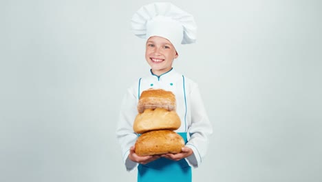 Young-Baker-Holds-Three-Loaves-Of-Bread-In-Her-Hands-And-Smiling-At-Camera