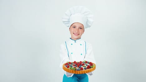 Young-Chef-Cook-Holds-Cake-Handmade-And-Smiling-At-Camera