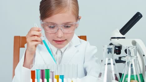 Young-Chemist-School-Girl-7-8-Years-In-Glasses-Mixing-Chemicals-In-Test-Tube