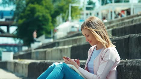 Young-Woman-Using-Your-Cell-Phone-And-Looking-Away