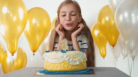 Child-Girl-Making-Wish-And-Blowing-Out-Candle
