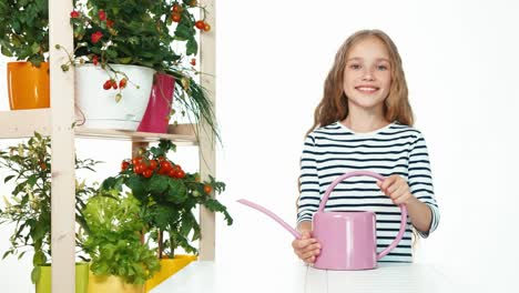Child-Holds-In-Her-Hands-Watering-Can-On-White-Background