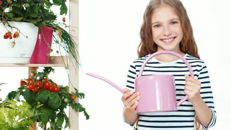 Child-Holds-Watering-Can-On-White-Background-Zooming