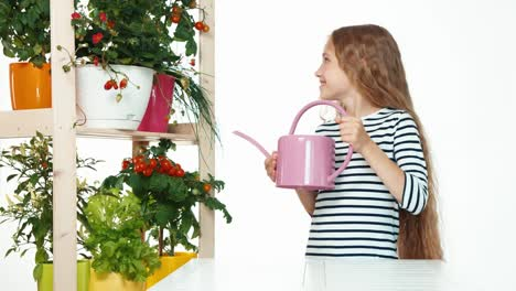 Child-Holds-Watering-Can-On-White-Background