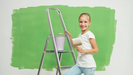 Child-Is-On-The-Ladder-Holds-A-Paint-Brush