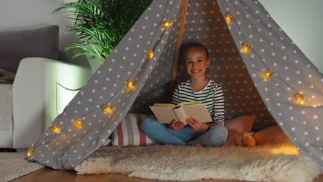 Child-Reading-Book-Girl-Sitting-In-Wigwam