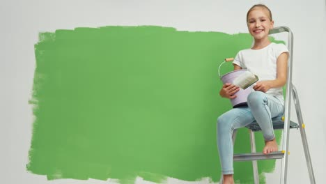 Child-Sitting-On-The-Ladder-On-Green-Screen