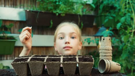 Child-Sowing-Seed-To-Soil