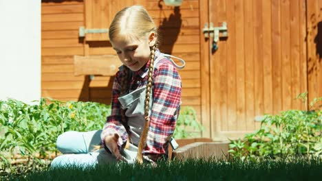 Child-Touching-Grass-In-Kitchen-Garden