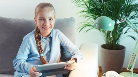 Child-Using-Tablet-PC-Indoors
