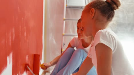 Child-With-Mother-Painting-Wall