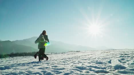 Family-Have-Fun-In-Sunny-Winter-Day-In-Mountains-Family-Dancing-On-Snow