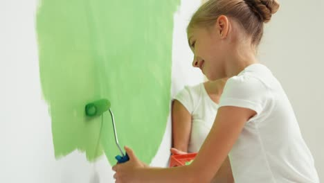 Family-Painting-Wall-To-Green-Color