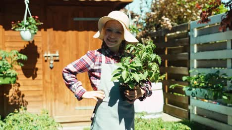 Farmer-Girl-Holds-Seedlings-Of-Vegetables-In-Her-Hands